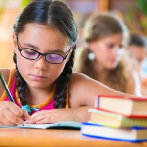 A girl studies in school. Image courtesy Olesya Feketa/shutterstock.com
