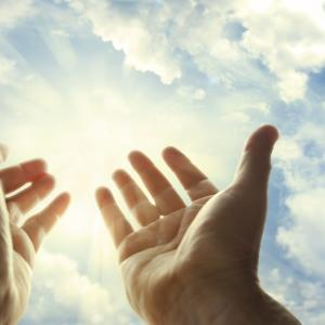 Hands in prayer. Image via STILLFX/shutterstock.com