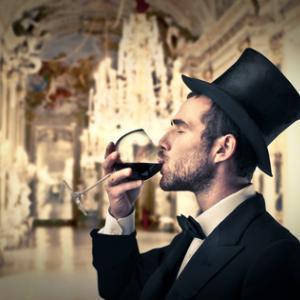Rich man drinking wine, ollyy / Shutterstock.com