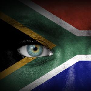 South African flag over human face, Aleksandar Mijatovic / Shutterstock.com