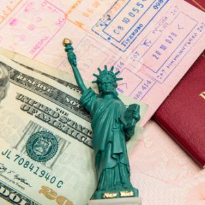Passport visa and money. Image courtesy mariakraynova/shutterstock.com.