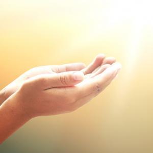 Hands in gratitude. Image courtesy CHOATphotographer/shutterstock.com