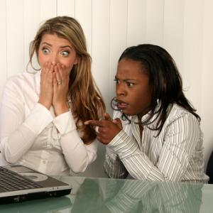 Women outraged looking at a computer screen, VanHart / Shutterstock.com