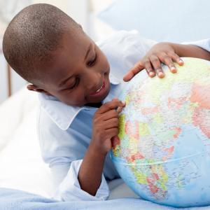 Small boy looking at his globe, wavebreakmedia / Shutterstock.com