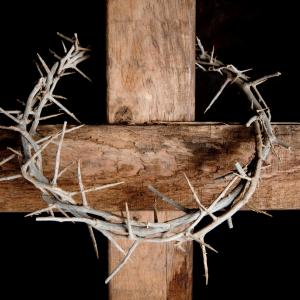 Crown of thorns hung around Easter cross, Anneka/Shutterstock.com