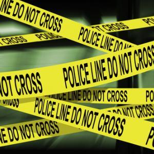 Police crime scene tape,  Luis Louro /Shutterstock.com