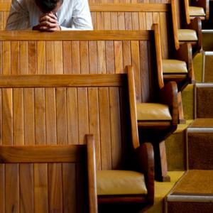 Praying image via Shutterstock