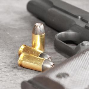 Gun image, val lawless / Shutterstock.com