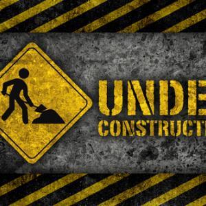 Under construction sign, L.Watcharapol / Shutterstock.com