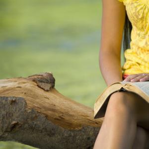 Woman reading Bible, Jacob Gregory / Shutterstock.com