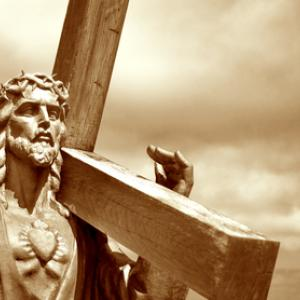 Jesus holding the cross, Kobets / Shutterstock.com