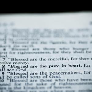 Bible opened to the sermon on the mount, Vibe Images/ Shutterstock.com