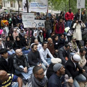 Imam leads muslims in a sermon at Occupy Wall Street by Lev Radin/Shutterstock.