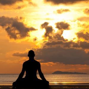 Man silhouette doing yoga, aragami12345s / Shutterstock.com