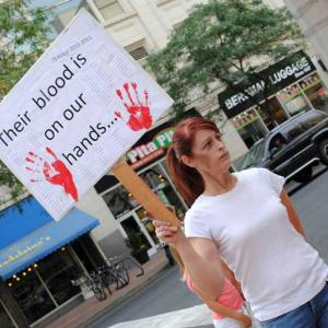Victoria Ann Thorpe protests against the death penalty outside of a Spokane mall