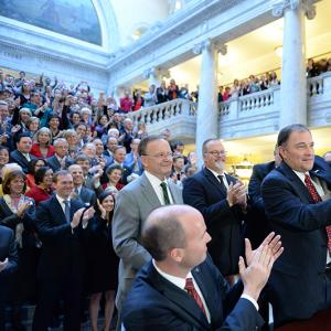 Utah Gov. Gary Herbert displays Senate Bill 296 after signing it into state law.