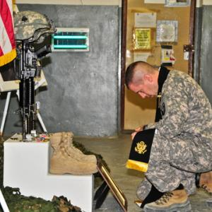 Army Chaplain Capt. Joseph Odell mourns a fallen soldie. RNS photo via Odell.