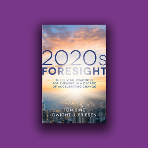 """The cover of the book """"2020s Foresight"""" shows the sky at sunrise and a city beneath it."""