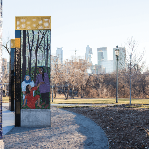 A Memorial to Survivors of Sexual Violence in Minneapolis. The murals are done with mosaics of blue, silver, brown and red colors.