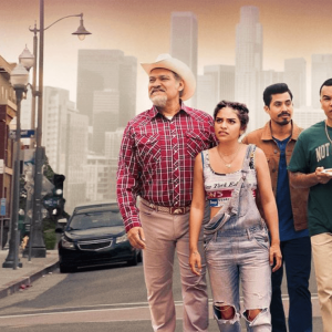 The Morales family in the show Gentefied stand on a street in Los Angeles.