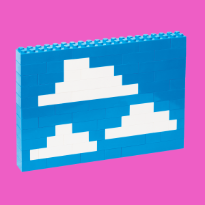 Legos built together to look like clouds in a blue sky.