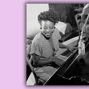 A portrait of Mary Lou Williams playing the piano and smiling.