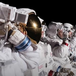A row of people in astronaut suits