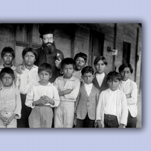 In this vintage photo, a bishop of a church stands among Indigenous children, a scene from 'Exterminate All the Brutes.'