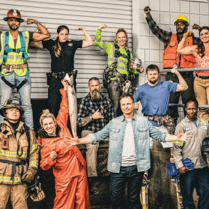 """Contestants from the reality show """"Tough As Nails"""" are blue collar workers. A group of 13 poses for a photo."""