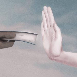 Illustration of a white person's hand refusing a book being held out by a Black person's hand.