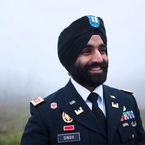 West Point graduate stands in dress uniform with beard and turban