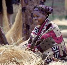 Ugandan woman photo, Nigel Pavitt / Getty Images