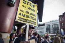 Protestors in DC march in solidarity with Baltimore. Image via JP Keenan/Sojourn