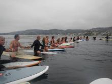 The paddle out for Mark Metherell, July 4, 2012. Photo by Carey Shyres.