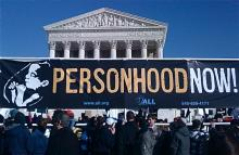 Personhood protest banner in front of the U.S. Supreme Court building during the