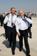President Barack Obama walks across the tarmac with Israeli Prime Minister Benja