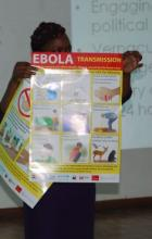 The Rev. Pauline Njiru, of Kenya displays a poster showing how Ebola can be tran