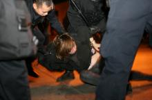 Occupy Oakland protester is arrested 1/28/12. Image via Getty Images.