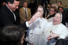 Rick Santorum greets nuns at a Knights of Columbus rally, Feb. 24. Getty Imagesa