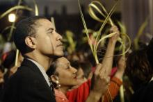 Obama at an April 4, 2004 Palm Sunday mass in Chicago. Via Getty Images.