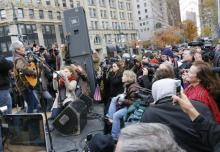 Joan Baez performs for Occupy Wall Street. Image from ph.cdn.photos.upi.com