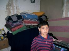 Syrian boy in rented flat in Mafraq, Jordan. MCC Photo/Nada Zabeneh