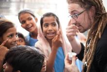 The author visits with children in India, 2010. Image via Facebook.