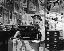 Photo: Man thinking at typewriter, Everett Collection / Shutterstock