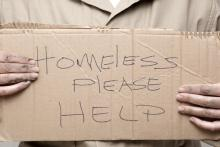 Homeless person asking for help, Kim Reinick / Shutterstock.com