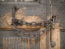 Locked church doors. Photo courtesy vesilvio/shutterstock.com