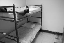 Beds in a homeless shelter, Nathan Kresge / Shutterstock.com