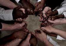 Hands held in a circle. Photo courtesy Brett Jorgensen/shutterstock.com