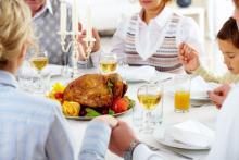 Photo: Family holiday meal, © Pressmaster / Shutterstock.com
