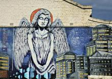 An angel surveys a city. Image courtesy Neale Cousland/shutterstock.com